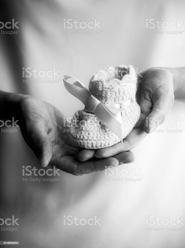 Hands holding a bootie stock photo