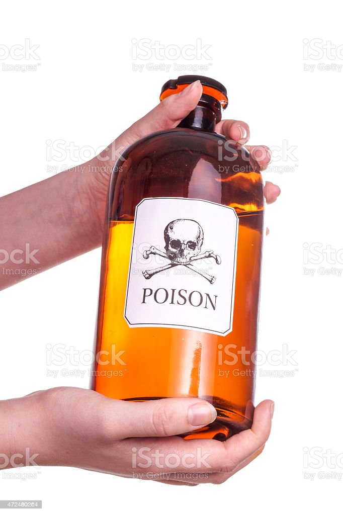 Hands holding a Bottle of poison. stock photo