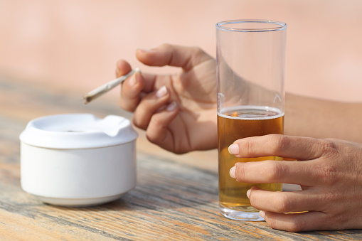 Hands Holding A Cigarette Smoking And Drinking Alcohol Stock Photo - Download Image Now