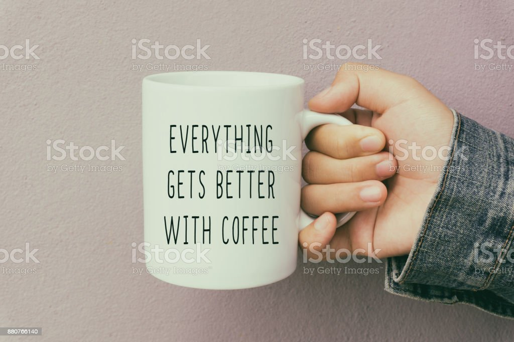 Hands Holding a Coffee Mug With Inspirational Quote stock photo