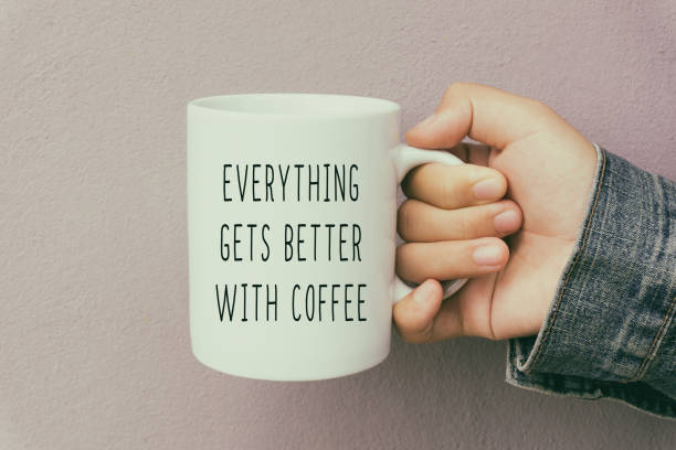 hands holding a coffee mug with inspirational quote - monday motivation stock photos and pictures