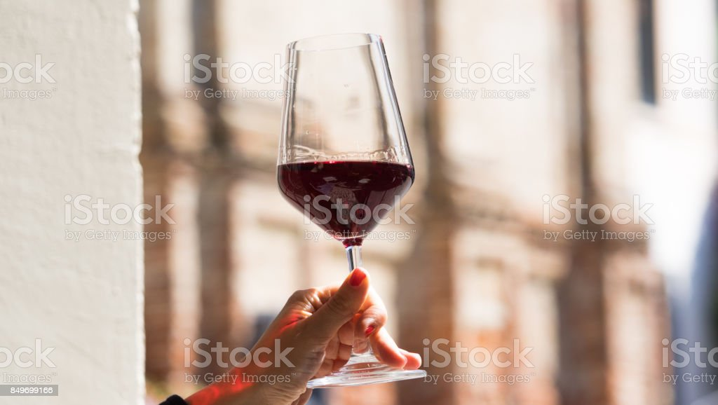 Hands holding a glass of vine stock photo