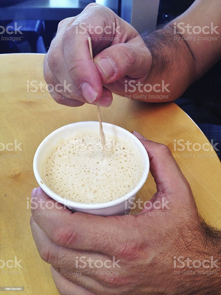 Hands Holding a Hot Cup of Coffee royalty-free stock photo