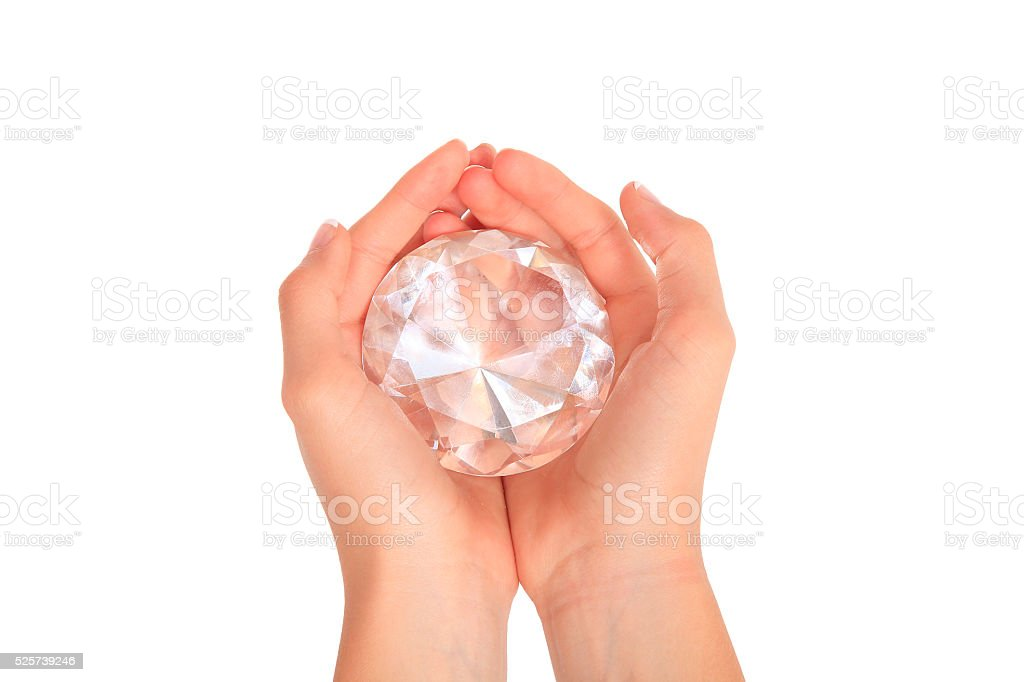 Hands holding a large gem stock photo
