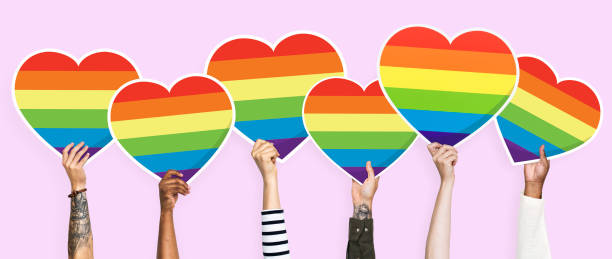 Hands holding a lgbt rainbow heart graphic Hands holding a lgbt rainbow heart graphic. lgbtqi rights stock pictures, royalty-free photos & images