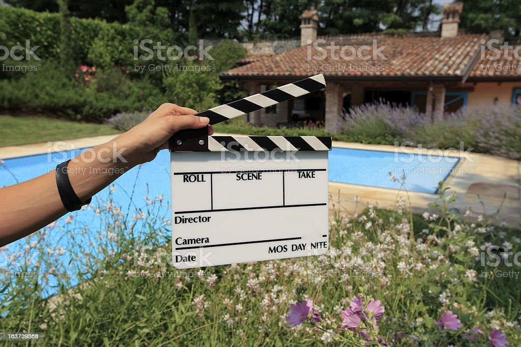 Hands holding a Movie Clapboard, ready for starting scene stock photo