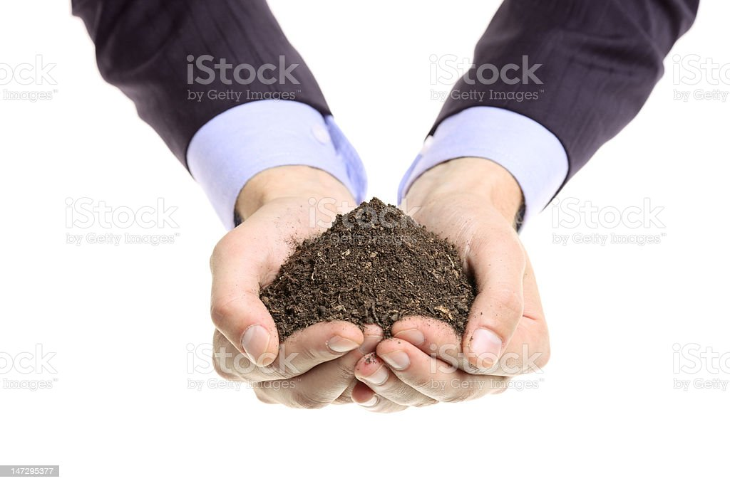 Hands holding a pile of soil royalty-free stock photo