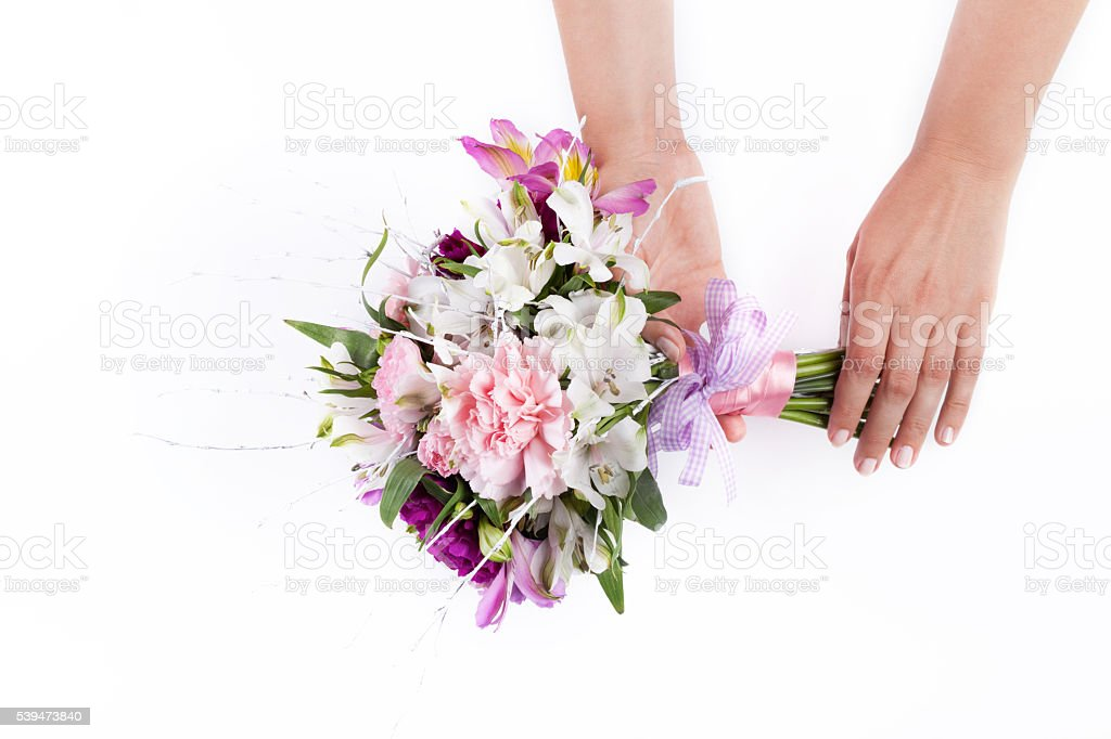 Hands holding a pink bouquet from gillyflowers and alstroemeria stock photo