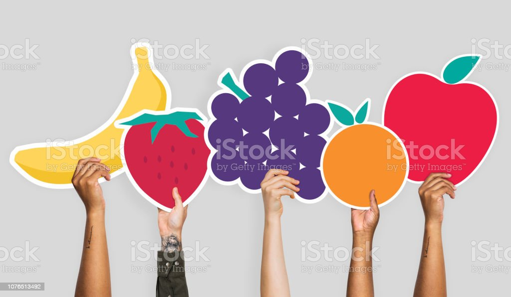 Hands holding a set of fruits clipart stock photo