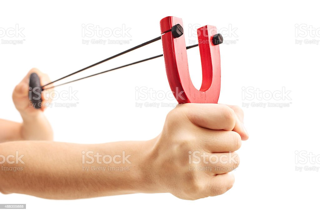 Hands holding a stretched slingshot  isolated on white backgroun stock photo