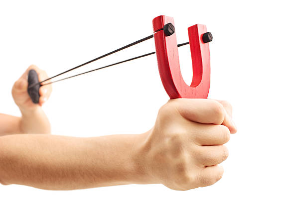 hands holding a stretched slingshot  isolated on white backgroun - katapult stockfoto's en -beelden