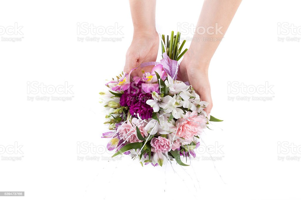 Hands holding a summer bouquet from pink and purple gillyflowers stock photo