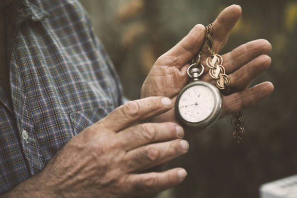 Hands holding a vintage pocket watch stock photo