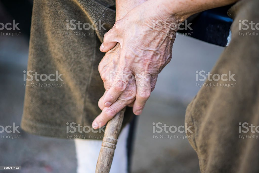 Hands holding a walking cane royalty-free stock photo
