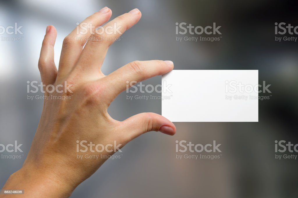 Hands holding a white business visit card, gift, ticket, pass,...