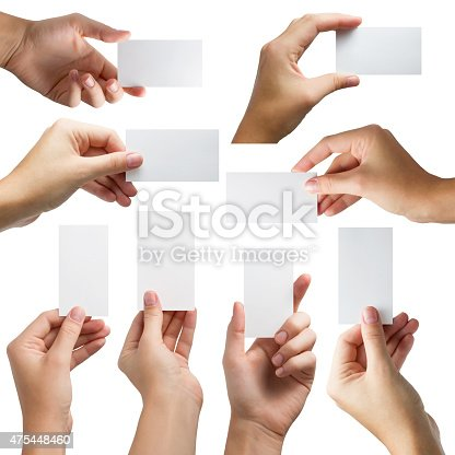 istock Hands holding a white paper blank isolated on white background 475448460