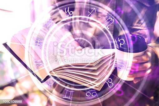 istock Hands holding abstract zodiac wheel book 1090109988