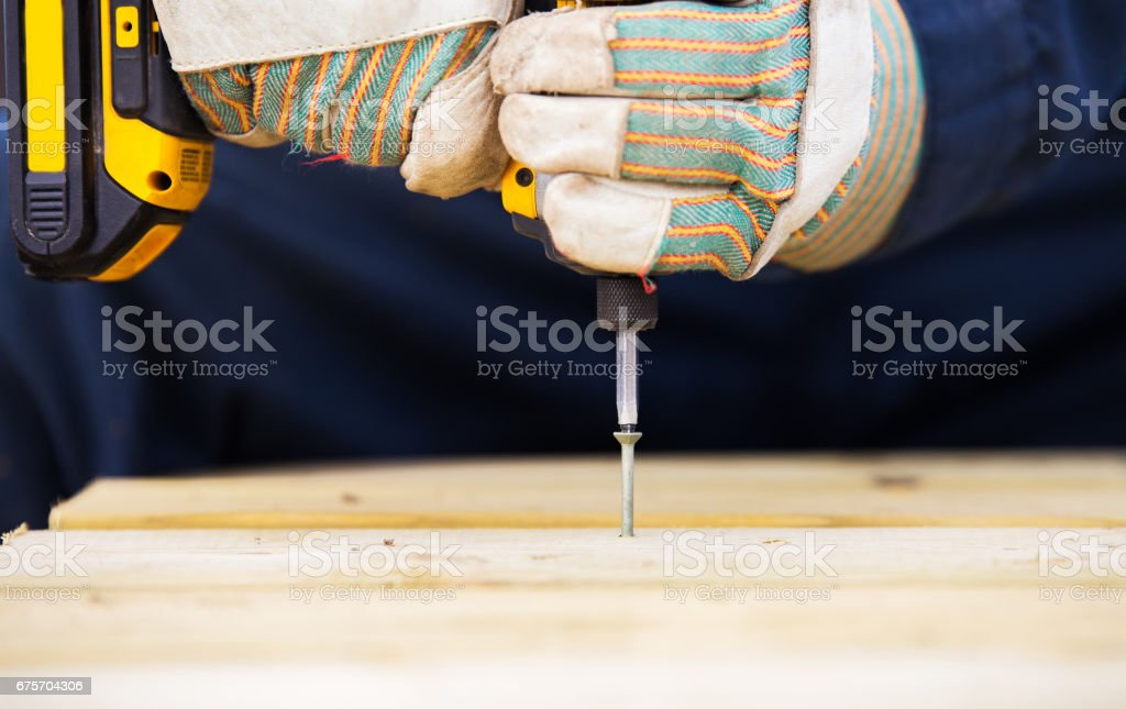 Hands holding an electrical drill royalty-free stock photo