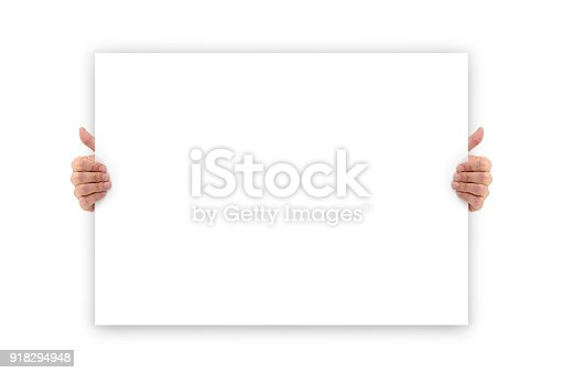 istock Hands holding an empty white advertising banner 918294948
