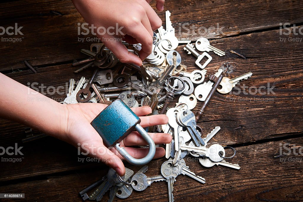 Hands holding an old metal keys. stock photo