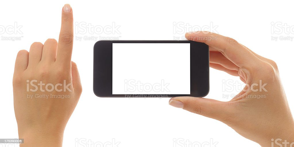 Hands holding and pointing with smart phone royalty-free stock photo