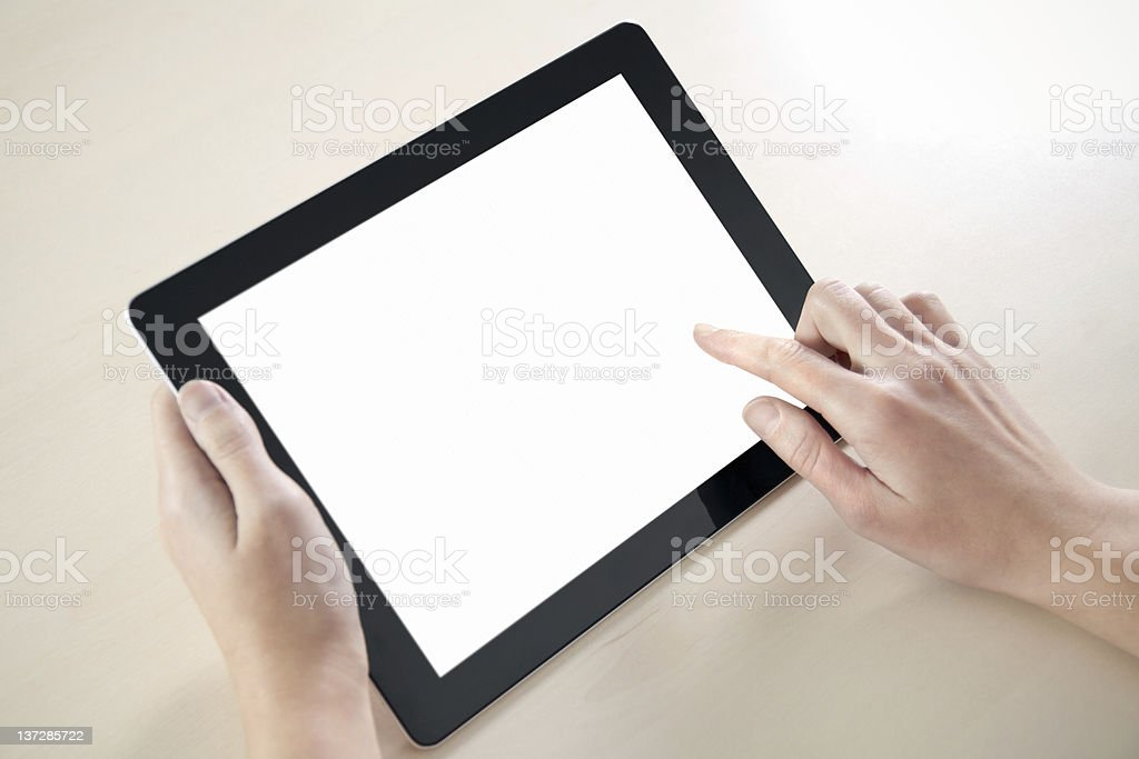 Hands holding and using electronic tablet royalty-free stock photo