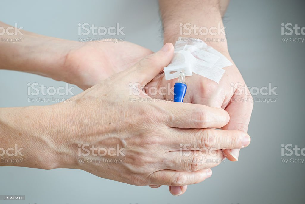 hands holding another hand stock photo