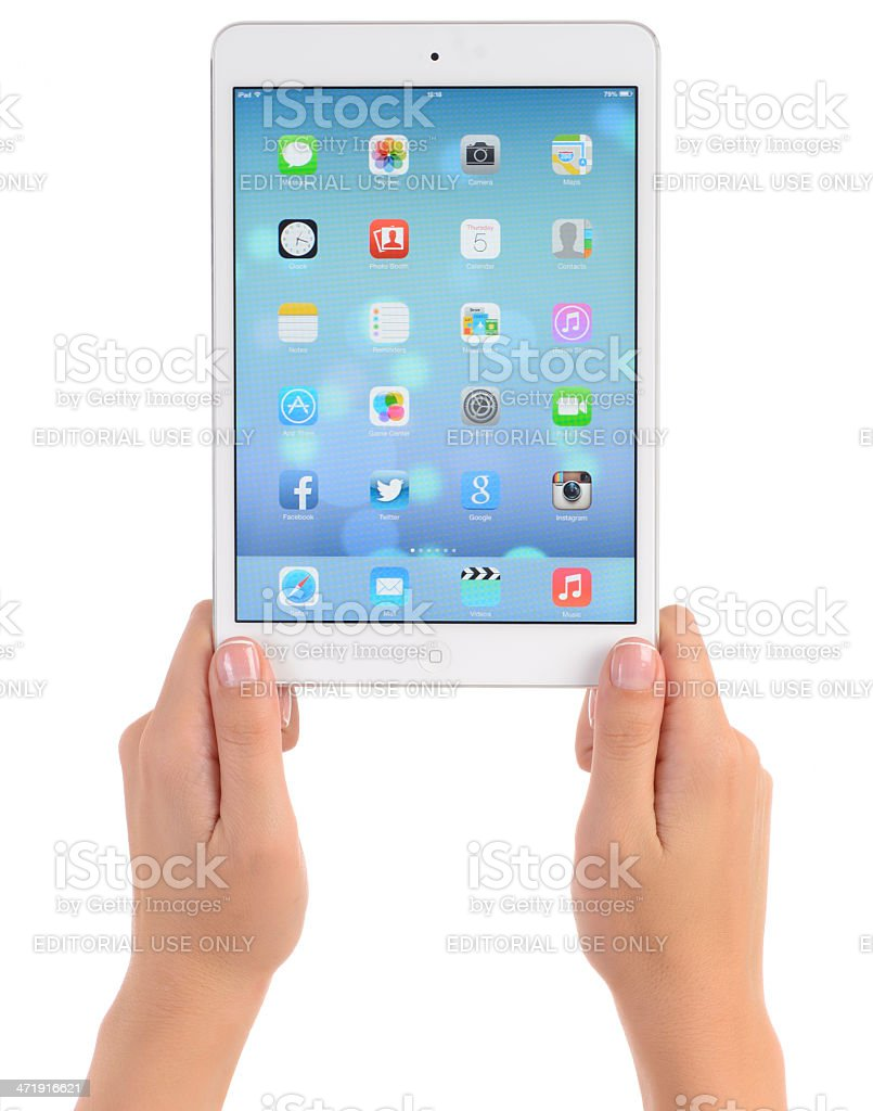 Hands holding Apple iPad Mini white royalty-free stock photo