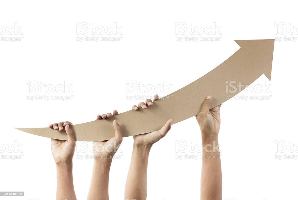 Hands holding arrow pointing upwards stock photo