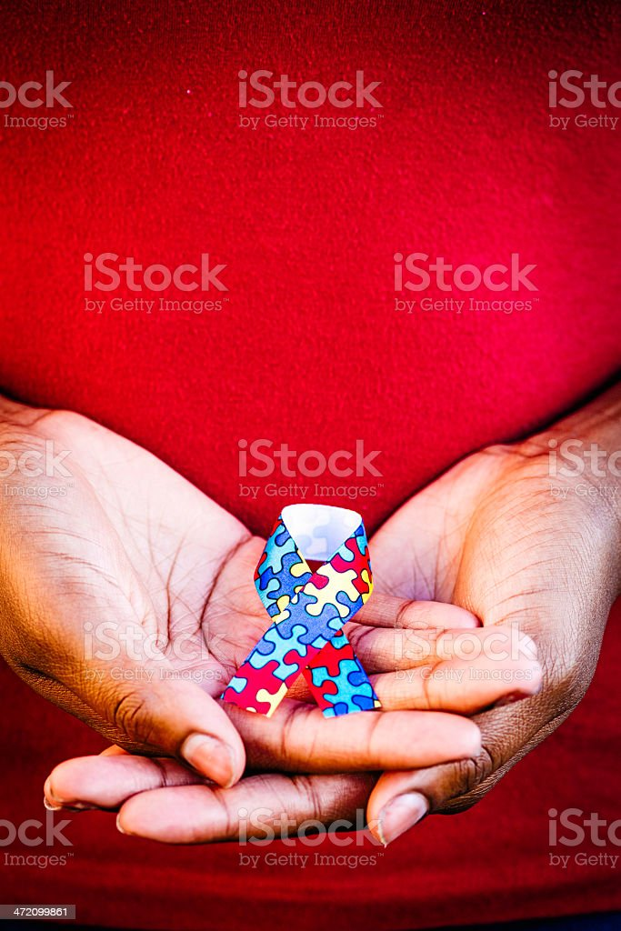 Hands Holding Autism Ribbon royalty-free stock photo