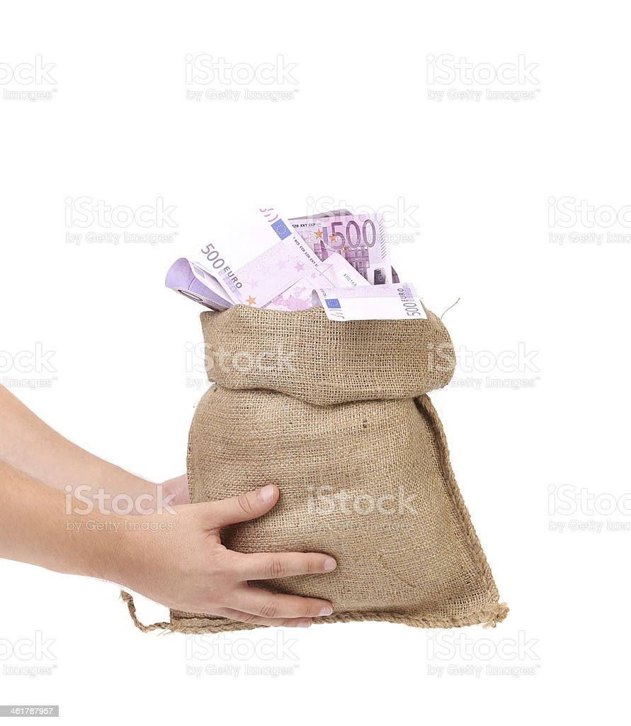 Hands holding bag full with euro bills. stock photo
