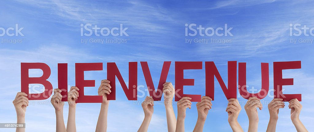 Hands Holding Bienvenue in the Sky stock photo