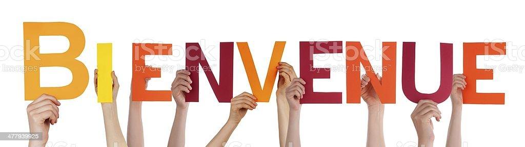 Hands Holding Bienvenue stock photo