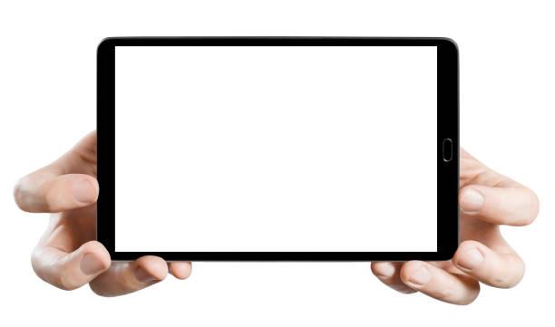 hands holding black tablet on white - hand holding phone стоковые фото и изображения