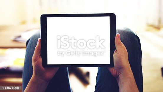 863476202 istock photo hands holding black Tablet phone with white empty screen, copy space 1146710981