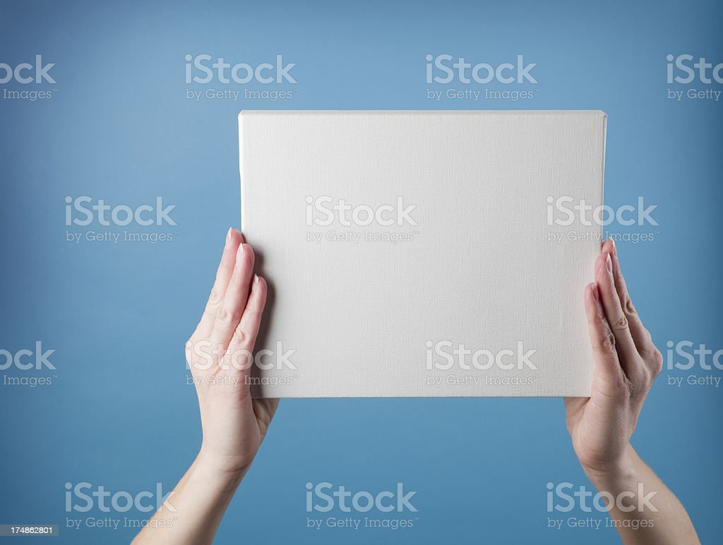 Hands Holding Blank Canvas royalty-free stock photo
