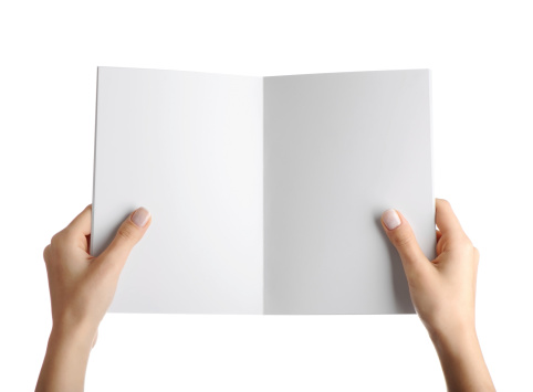 Hands holding blank magazine page for insertion of any document or text.isolated on a white background.