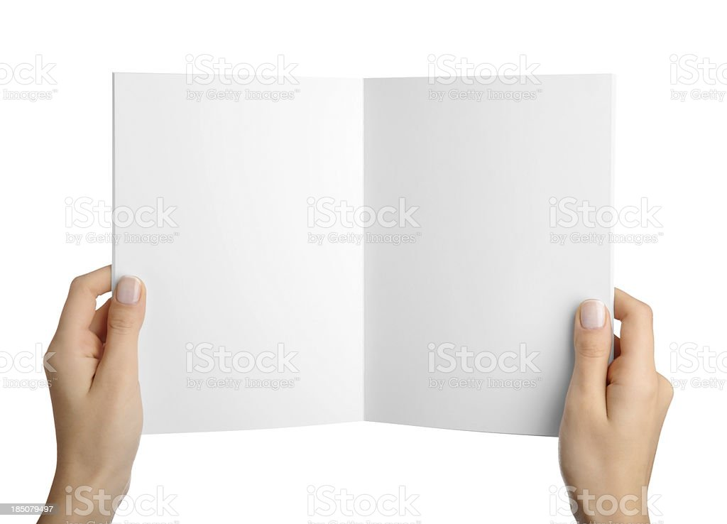 Hands holding blank magazine page stock photo