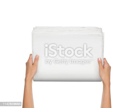 istock Hands holding blank newspaper isolated on white 1142839665