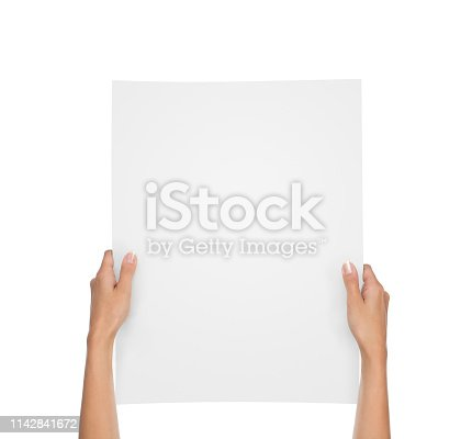 istock Hands holding blank paper sheet isolated on white 1142841672