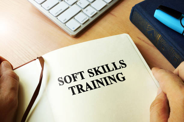 hands holding book with title soft skills training. - softness stock pictures, royalty-free photos & images