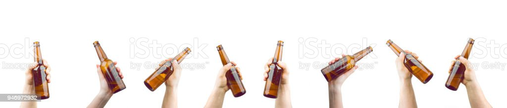 Hands Holding Bottles Of Beer stock photo