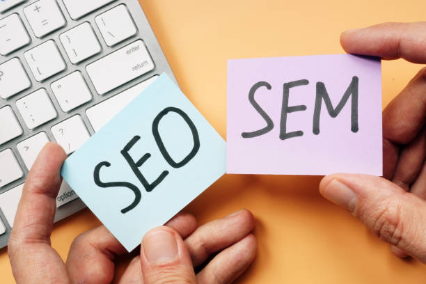 Hands holding cards with SEO and SEM. Hands holding cards with SEO and SEM. sem stock pictures, royalty-free photos & images