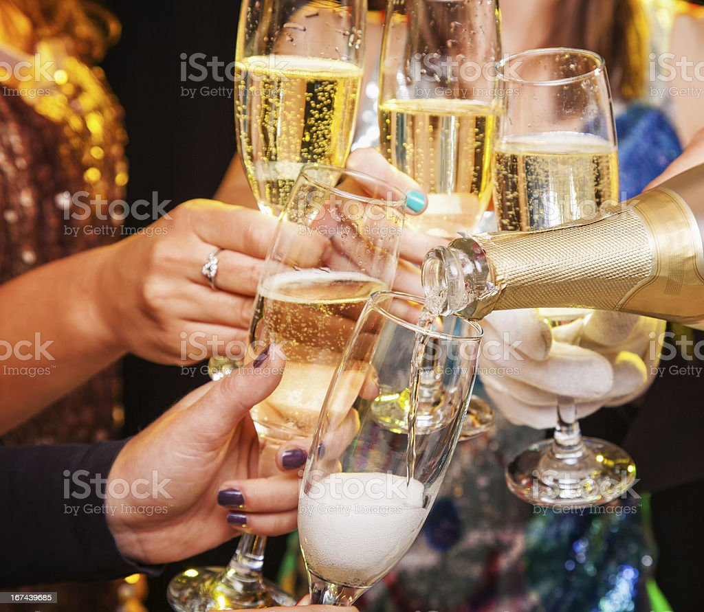 Hands holding champagne glasses during a toast stock photo