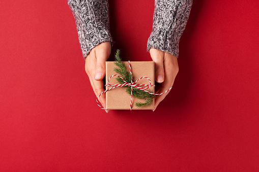 istock Hands holding Christmas gift box. 1048398138