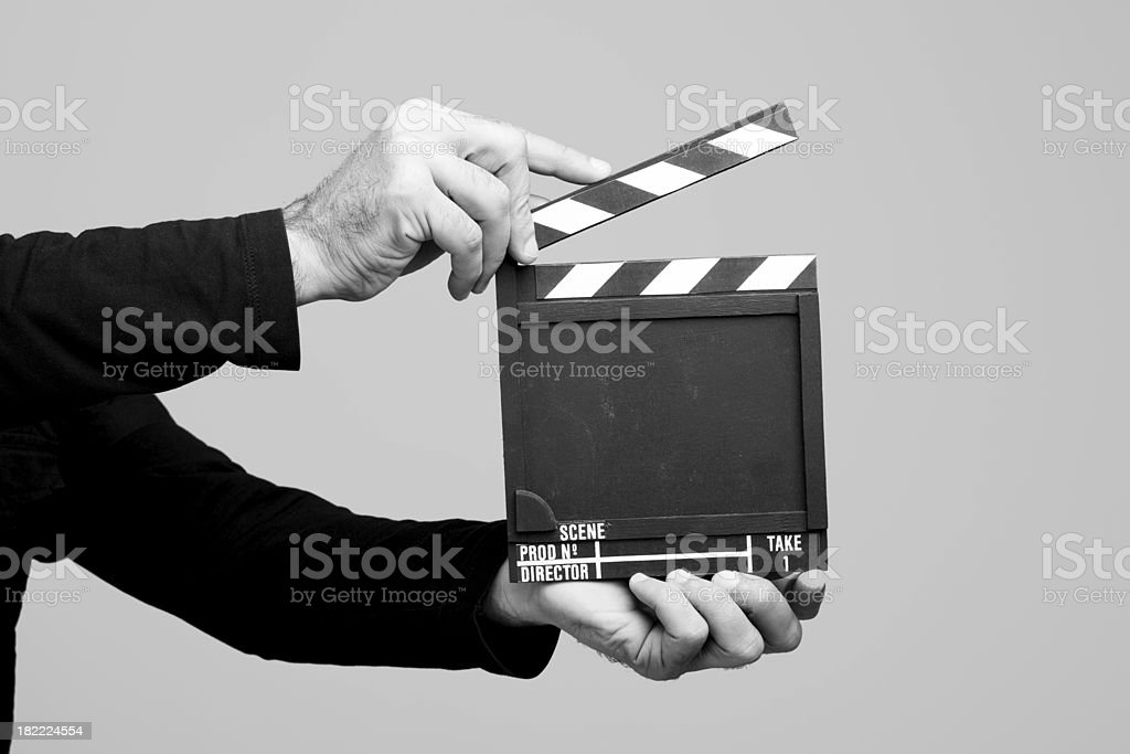 Hands holding clapperboard royalty-free stock photo