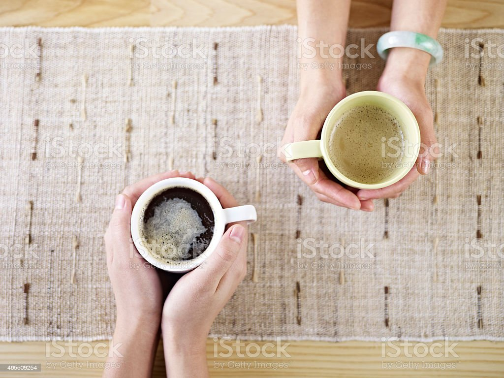 hands holding coffee stock photo