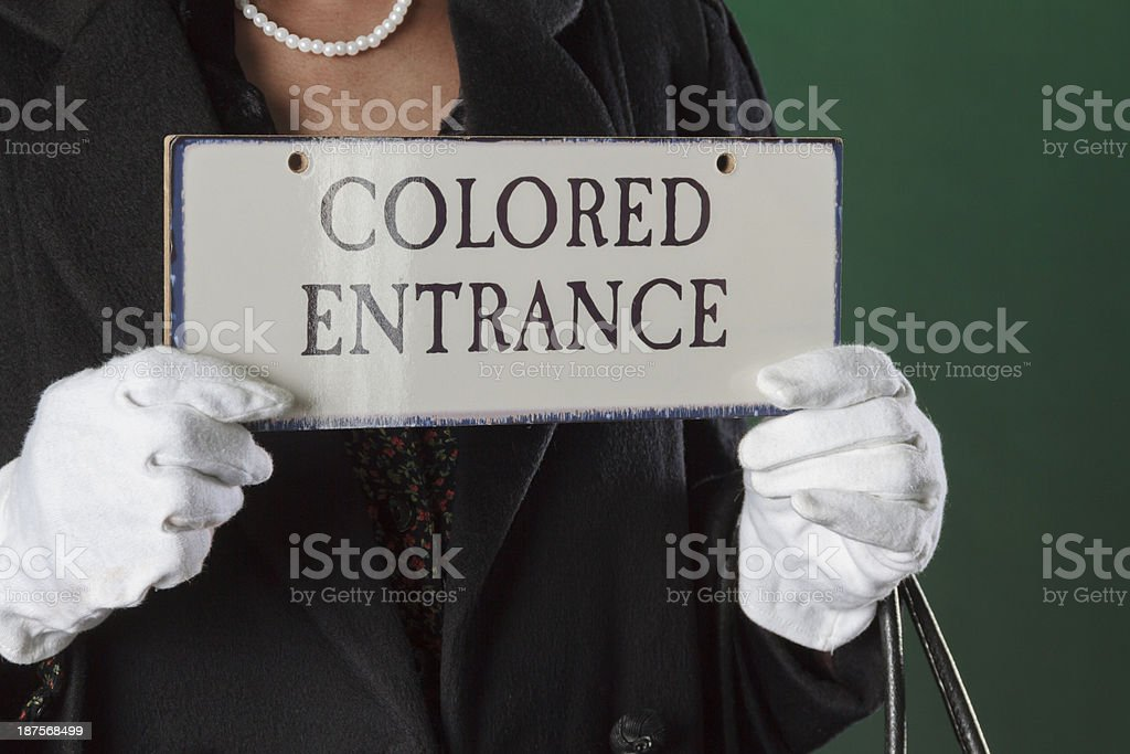 Hands Holding Colored Entrance Sign From the American Fifties stock photo