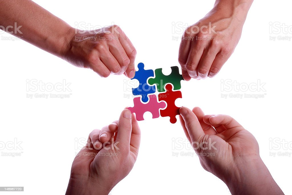 Hands Holding Colourful Jigsaw Puzzle Pieces royalty-free stock photo