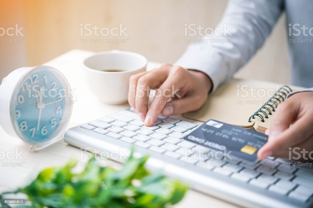 Hands holding credit card and using laptop. Online shopping royalty-free stock photo